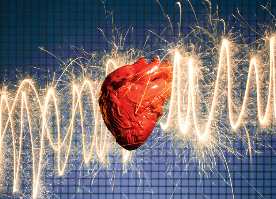 A heart with the trailings of a sparkler in the background in the pattern of an EKG reading.