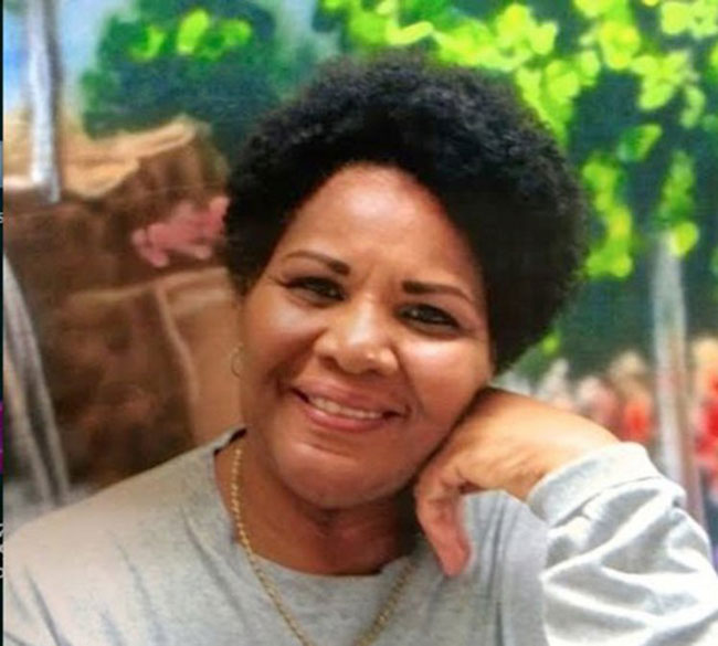 A photo of Alice Marie Johnson with resting her face on her hand.