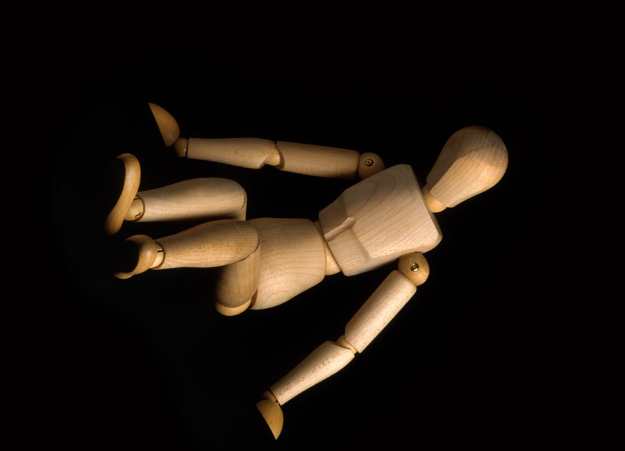 A wooden doll sectioned off at the joints of the body.