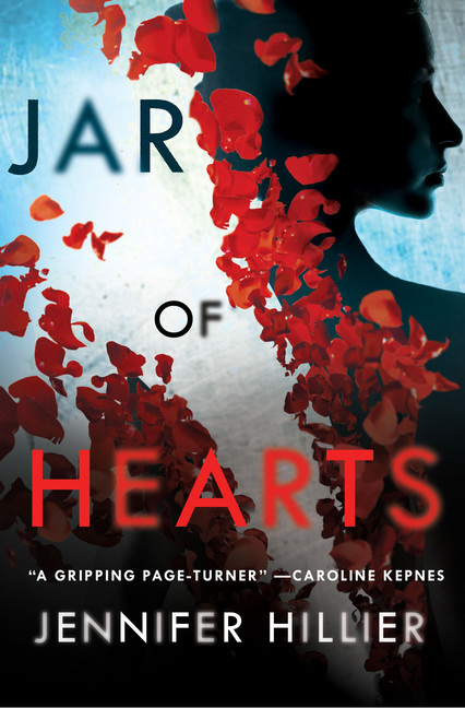 The book cover for Jar of Hearts. Flower pedals spread over a shadowed silhouette of a woman behind the title.