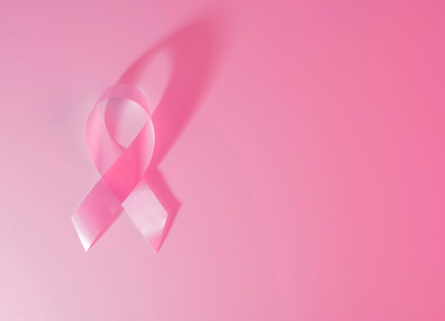 Pink ribbon alone on pink background