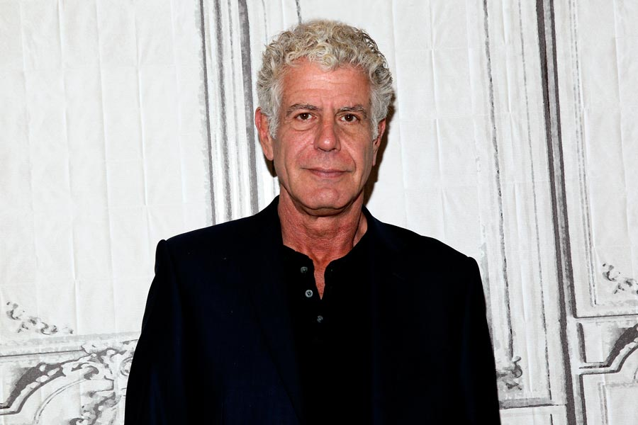A photo of Anthony Bourdain wearing a black shirt.