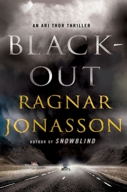 The book cover for blackout. In the background of the title is a cloudy night sky over a highway.
