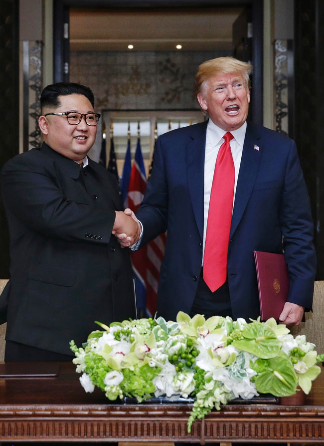 North Korean leader Kim Jong-un and Donald Trump shake hands