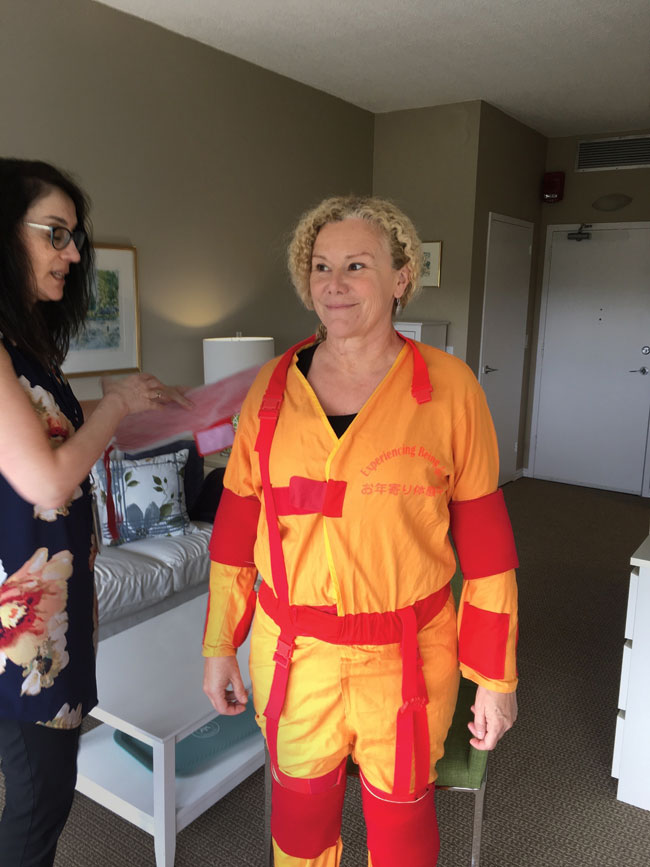 Woman in orange and red simulation suit.