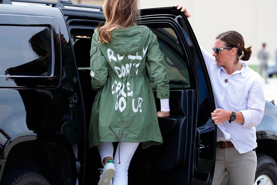 "Melania Trump enters a car wearing a jacket that reads ""I don't really care do you?"""