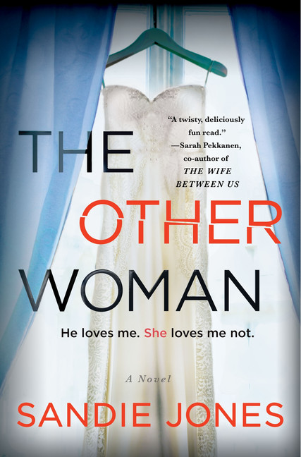 The book cover for The Other Woman. Behind the title text is a wedding dress hanging in the opening of blue curtains.