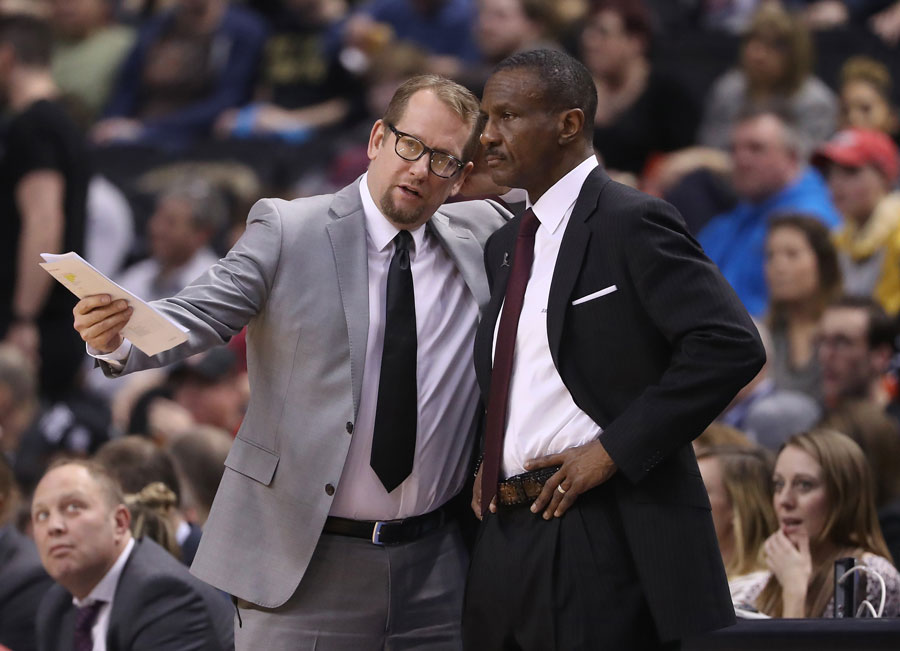 Nick Nurse and Dwayne Casey coaching on the sidelines of a Toronto Raptors game.