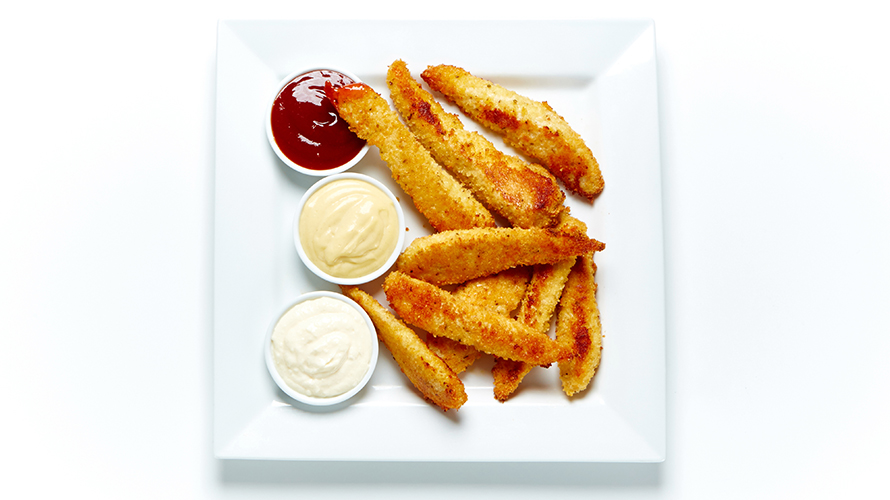 Parmesan chicken fingers with three types of sauces on the side.