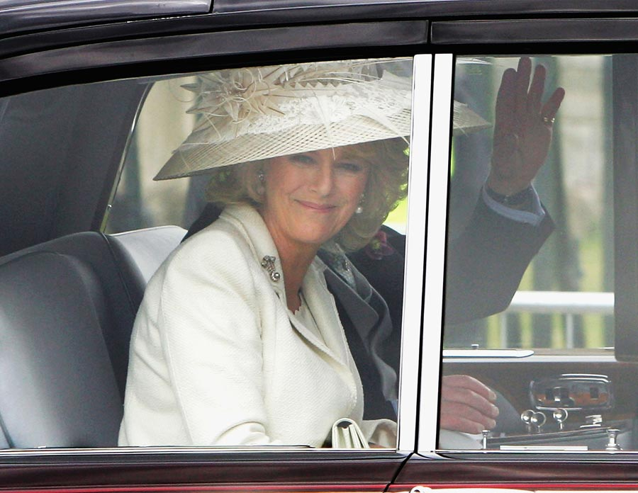 The Prince of Wales and The Duchess of Cornwall are driven from Windsor Guildhall after being married on April 9, 2005 in Windsor, England. The couple married in a civil ceremony at Windsor Guildhall, before a church blessing at Windsor Castle. (Photo by Scott Barbour/Getty Images)