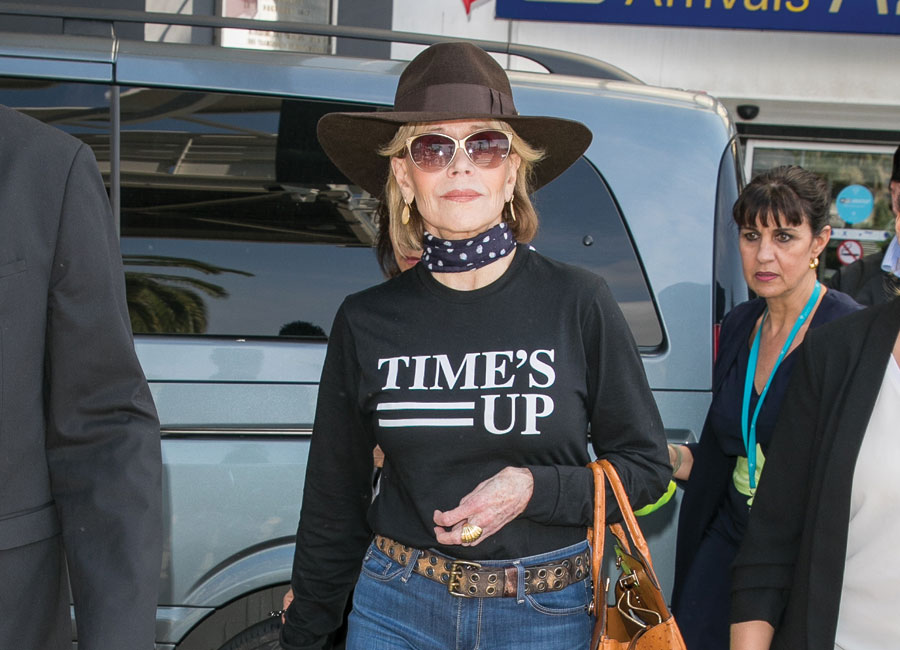 Jane Fonda arriving in Cannes wearing a black Time's Up T-shirt.