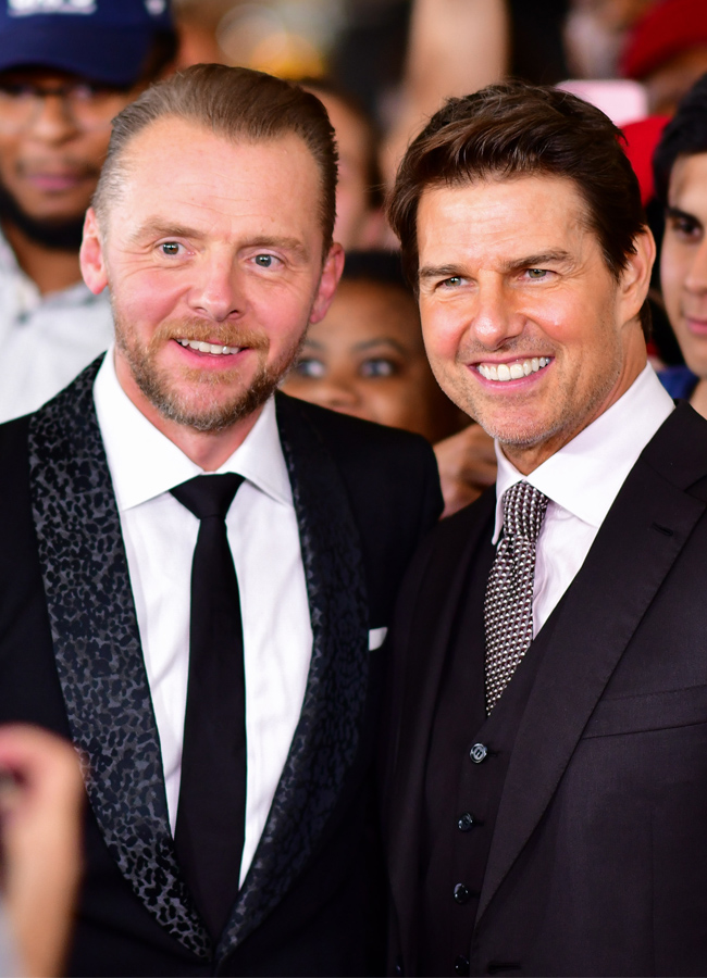 Simon Pegg and Tom Cruise posing for photos at the Mission Impossible Fallout premiere