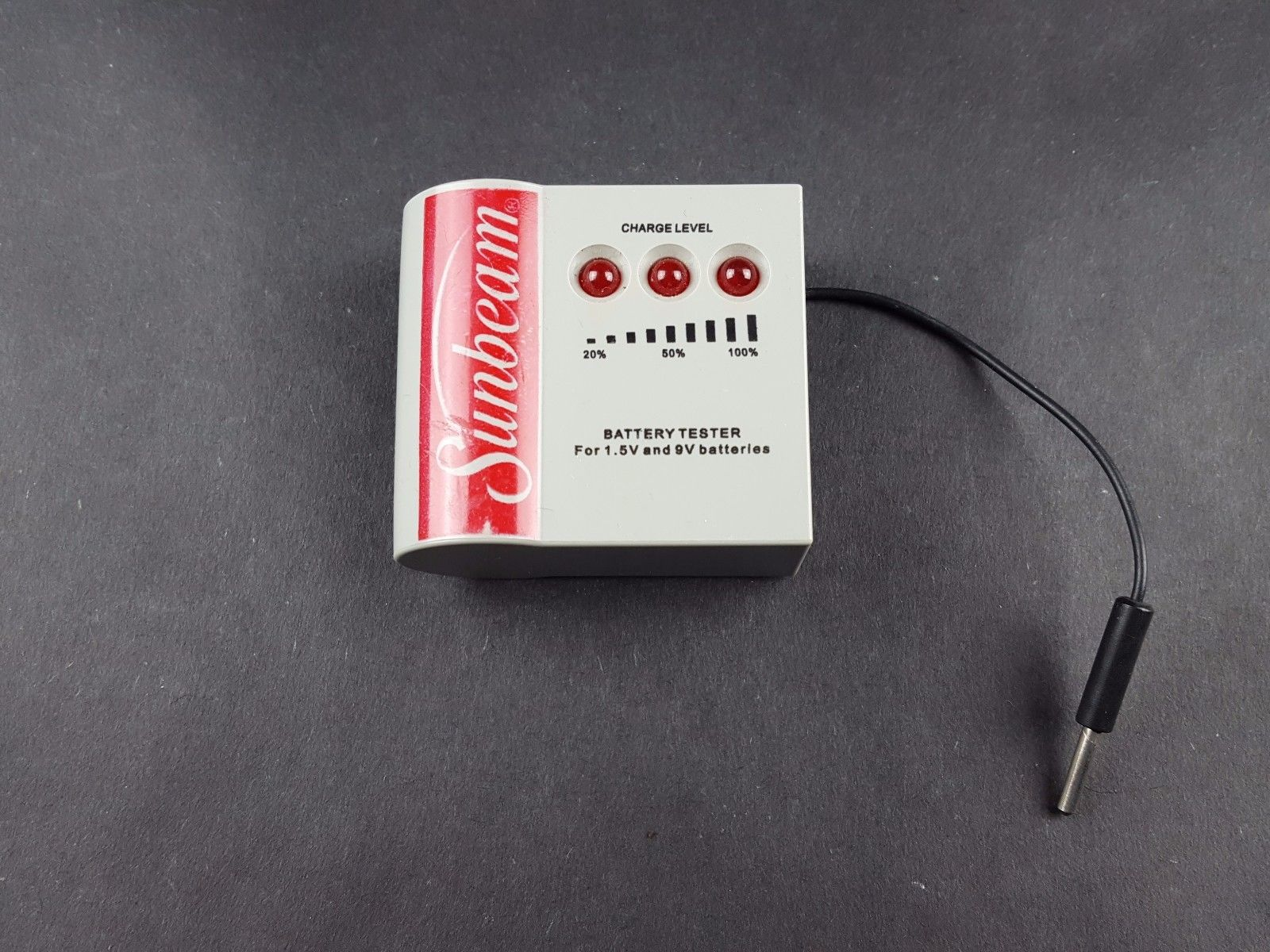 A battery tester with lights that indicate the percentage left in a battery.