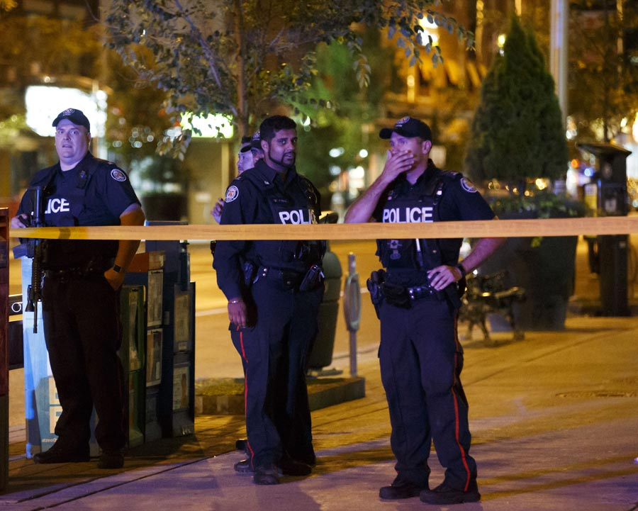 police officers standby after Greektown shooting