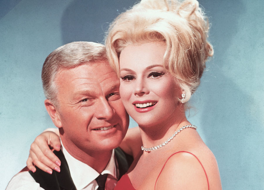 Eva Gabor and Eddie Albert embrace in a publicity still for the CBS series Green Acres. Eddie and Eva play husband and wife on the show.