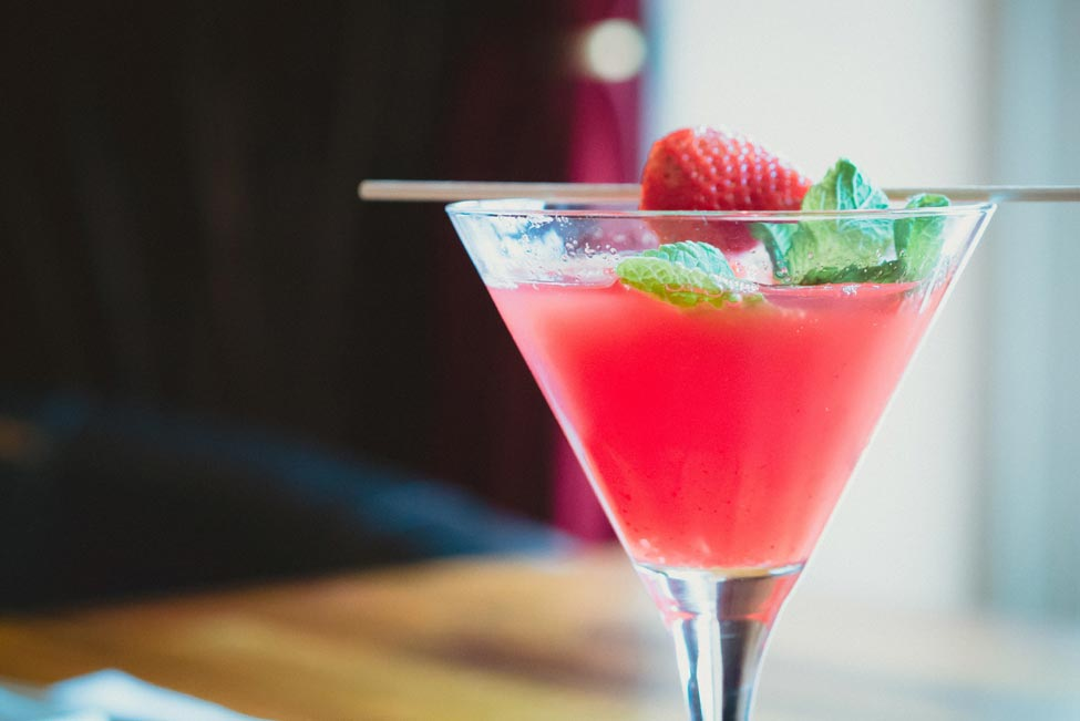 Pink cocktail with a strawberry