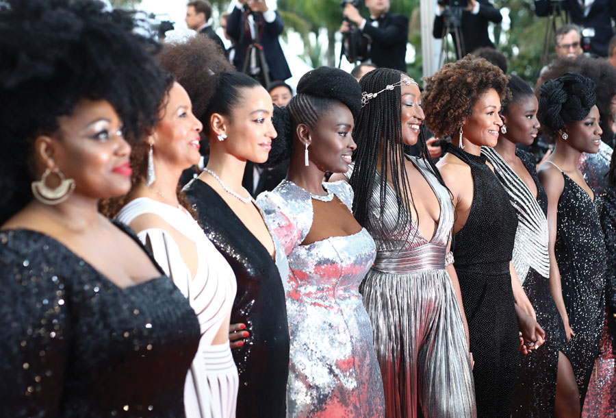16 international black female actors stand arms linked in protest of the lack of diversity in the Cannes Film Festival.