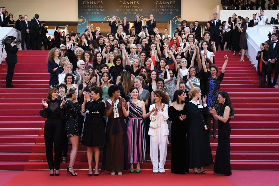 A diverse group of 82 actresses stand on the steps of the Palais des Festivals to signify the challenges women face in the industry.