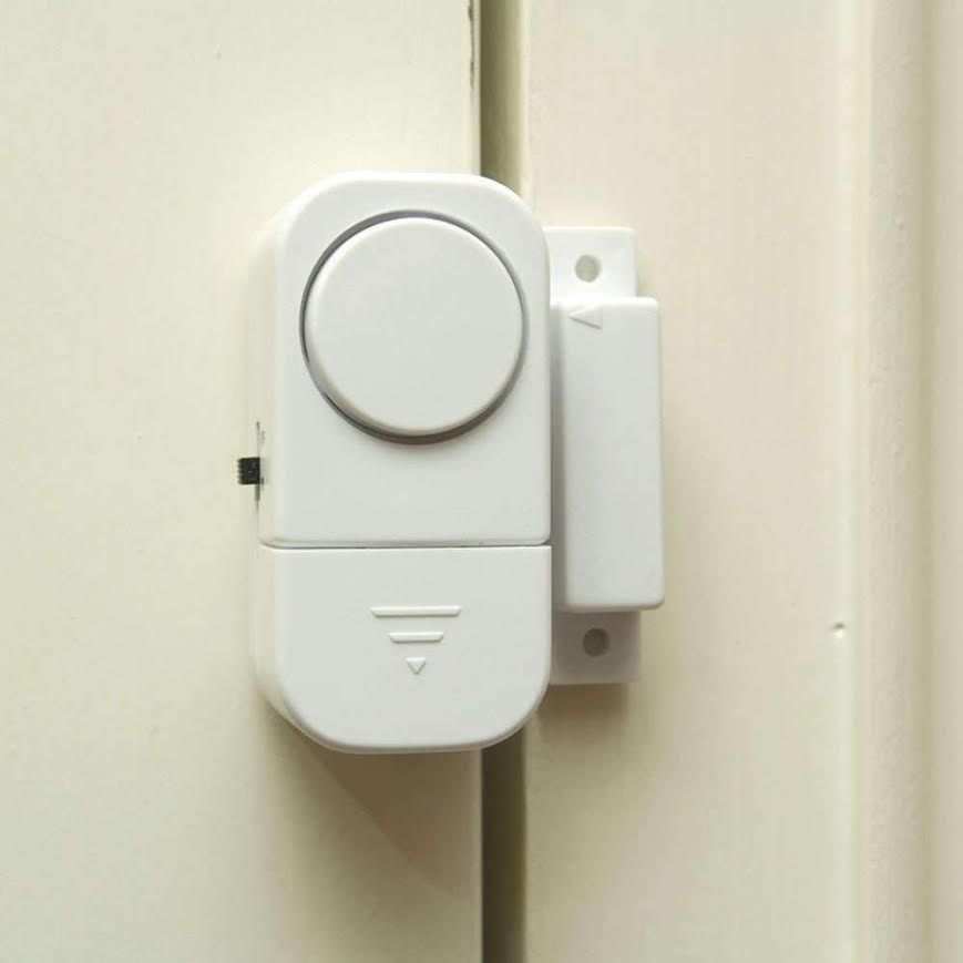 An alarm that creates a seal between your door and the door frame and sounds when the door is opened.