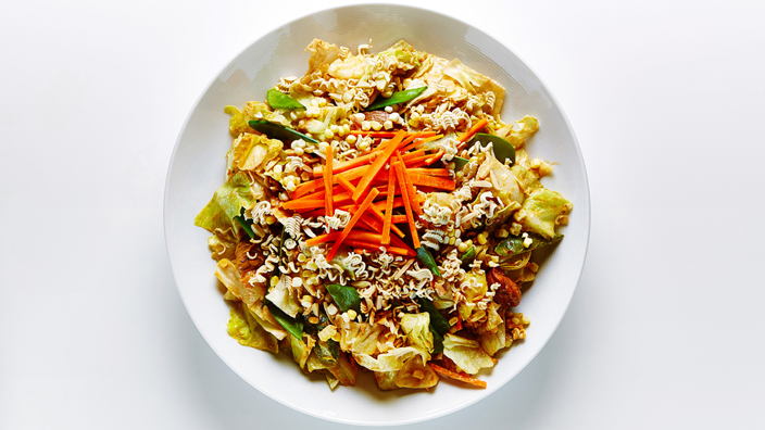 Chinese chicken salad in a white bowl.