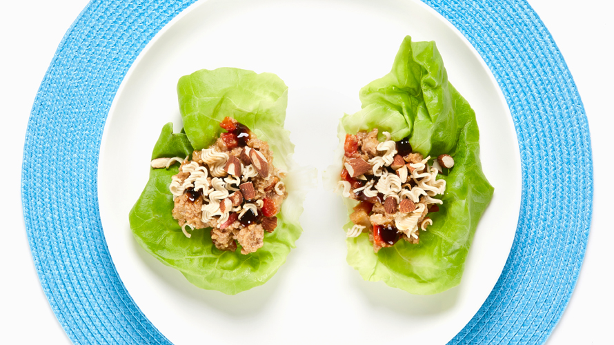 Chicken lettuce wraps sitting on a white plate.