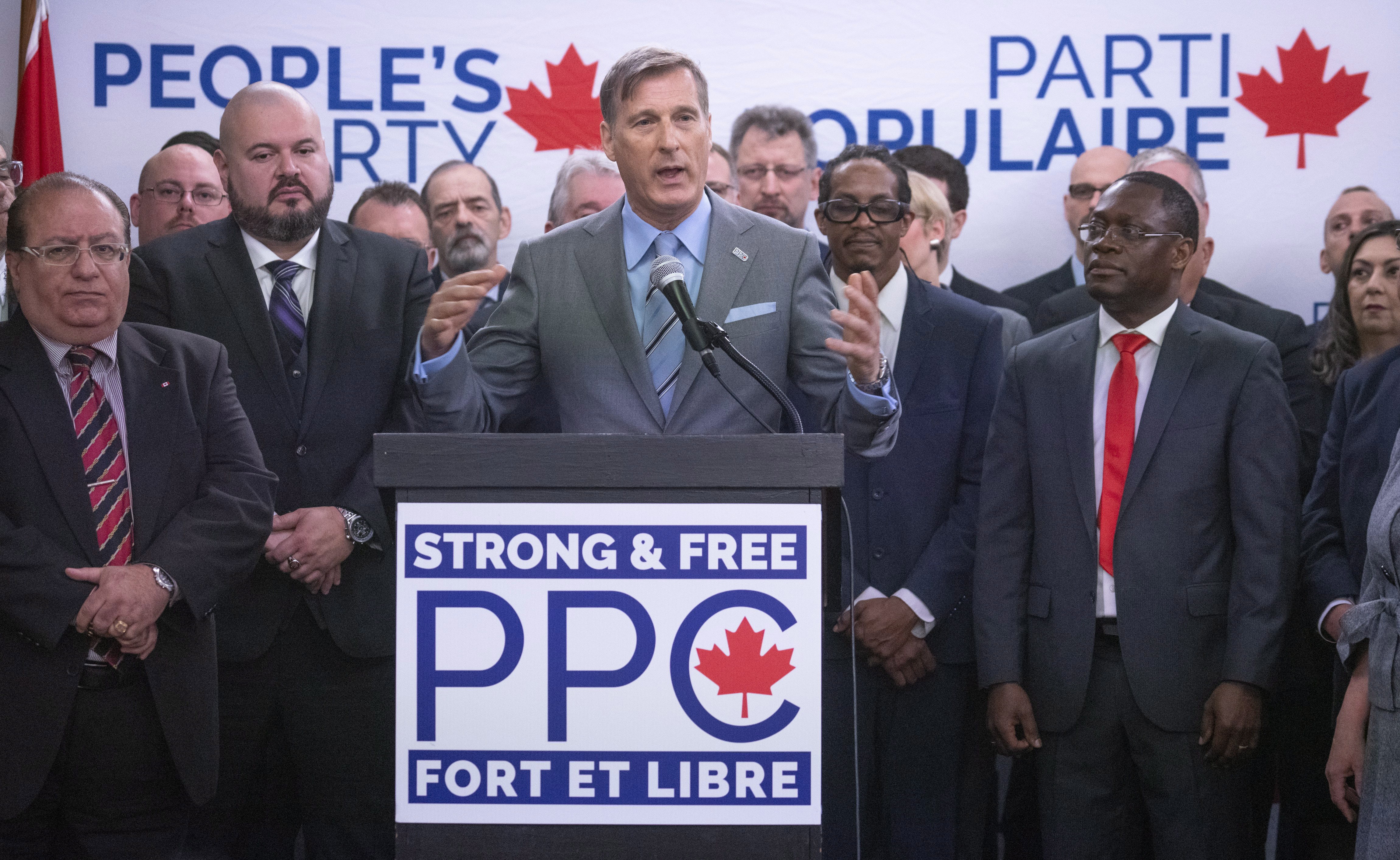 People's Party leader Maxime Bernier stands at a podium.