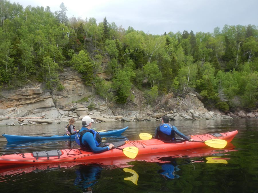 Sea kayaking along the shoreline of Gaspe Bay with Cap Aventure outfitters.