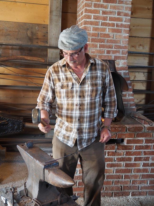 Blacksmith working at Banc de Peche.