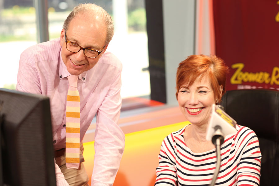 Intern, Lawrence Franklin with radio personality Libby Znaimer smiling at a computer screen.