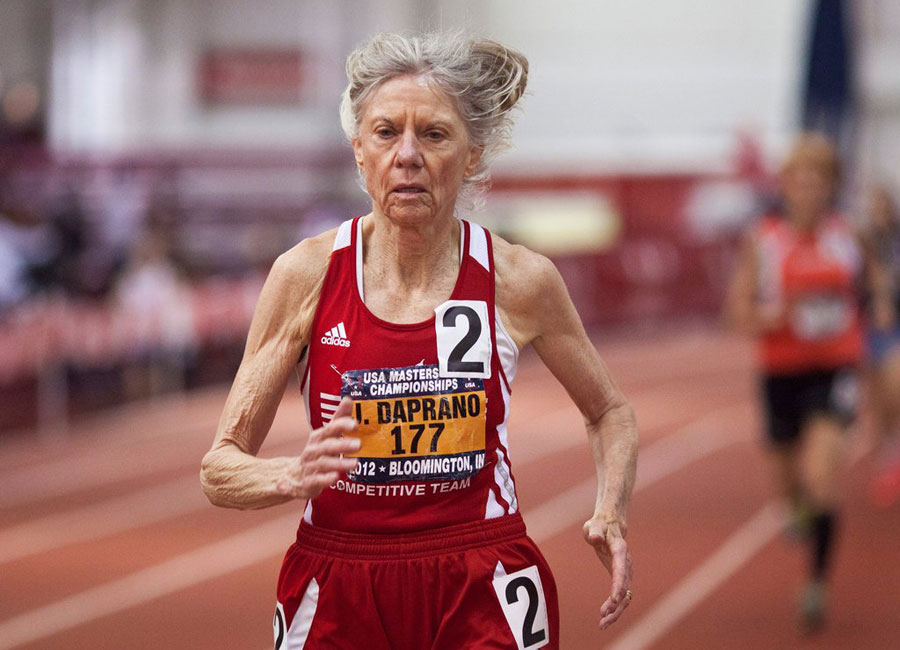 81-year-old Jeanne Daprano in mid-stride on the track.