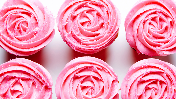 Cupcakes covered in pink icing.