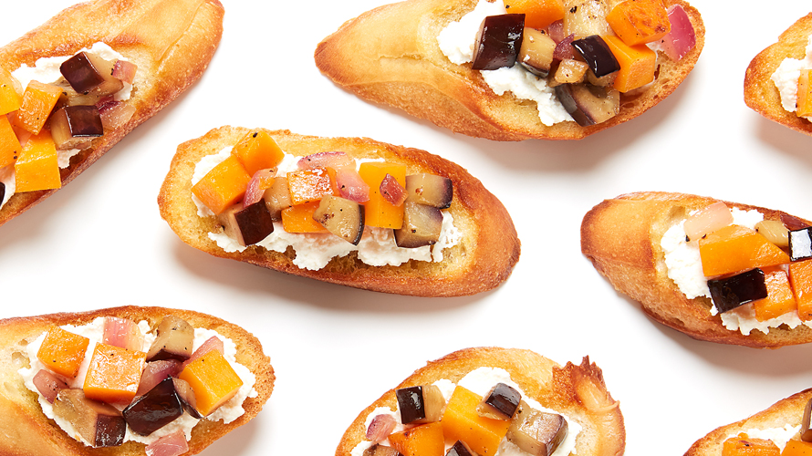 Eggplant and butternut squash bruschetta on a white background.