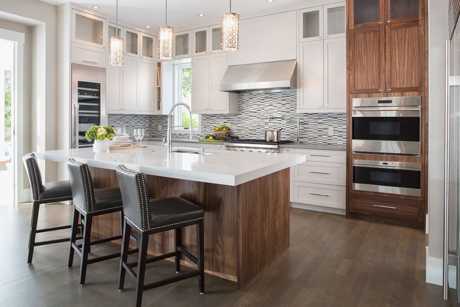 A large luxurious kitchen with an island.