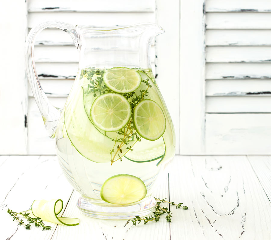 Glass pitcher filled with water, and cucumber