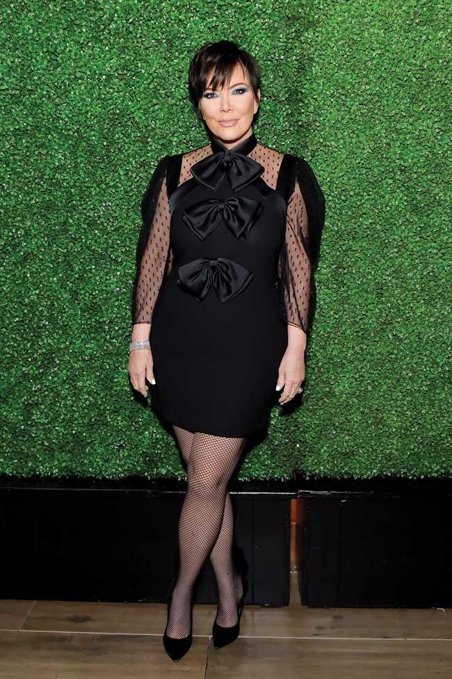Kris Jenner wearing a black mini-dress.