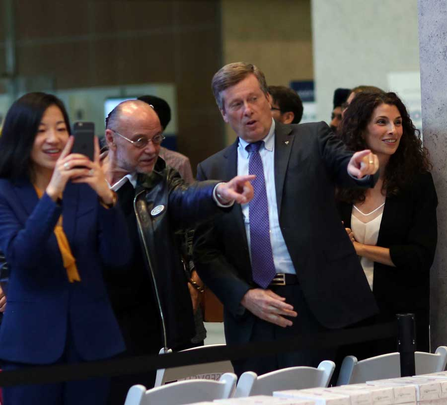 Mayor John Tory and Moses Znaimer pointing excitedly in the same direction.