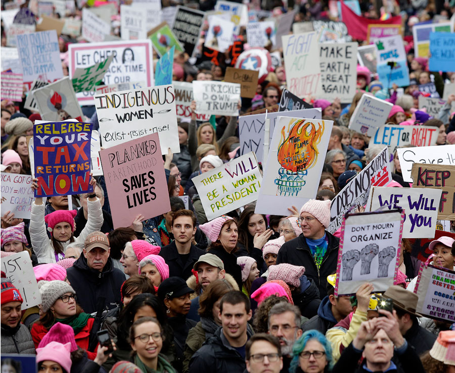 Demonstrators protest during the Women's March along Pennsylvania Avenue January 21, 2017 in Washington, DC.