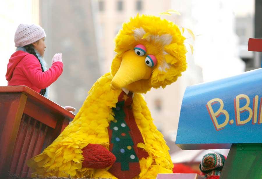 Big Bird on a float at a parade.