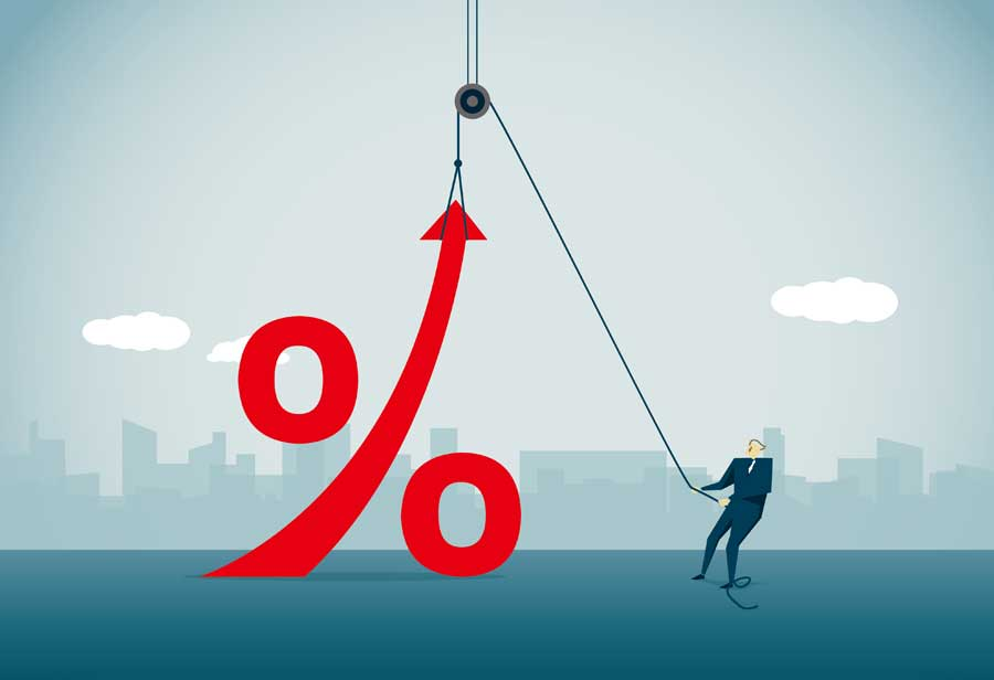 An illustration of a man in a suit using a pulley to lift a percentage symbol.