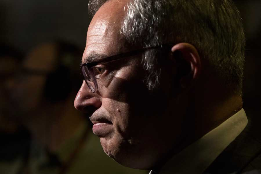 Tony Clement looking concerned on a black background.