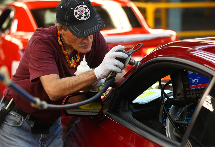 Auto worker working on a GM car.