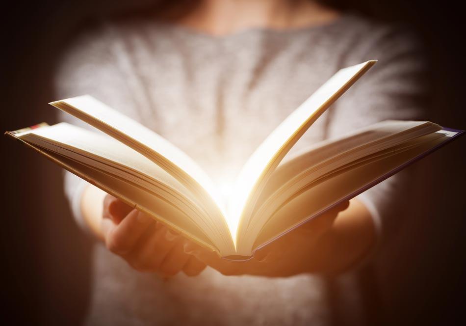 Woman holding an open book.