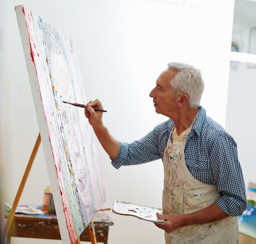 A man paints at an easel