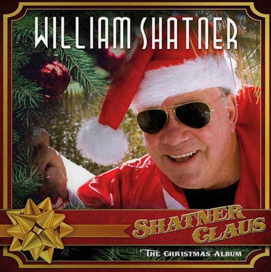 William Shatner on the cover of his new Christmas Album Shatner Clause, wearing a santa hat and aviator sunglasses.