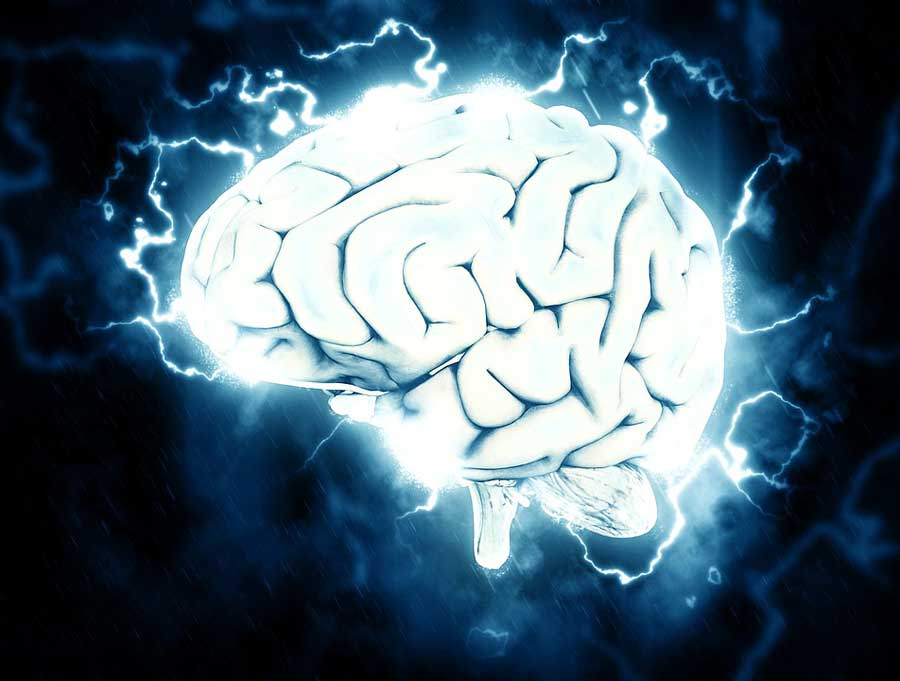 A luminescent illustration of a brain with surges of electricity surrounding its outer edge.