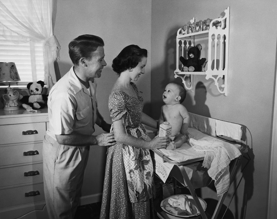 A 50s-era couple and baby at the change table