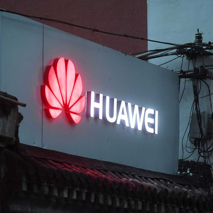 A neon sign for Huawei phone company.