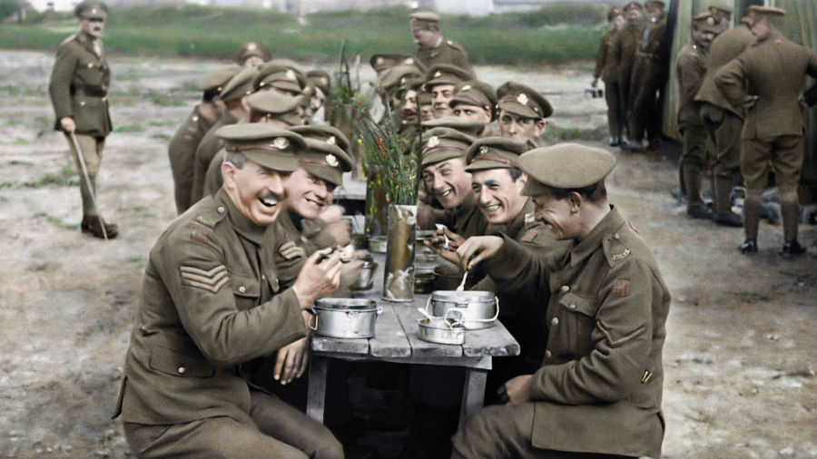 British soldiers sit down for a meal during the first world war.