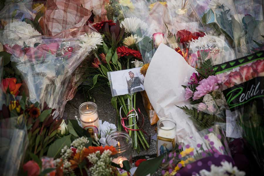 Cpl. Nathan Cirillo's photo surrounded by flowers and candles, part of a memorial on parliament hill.