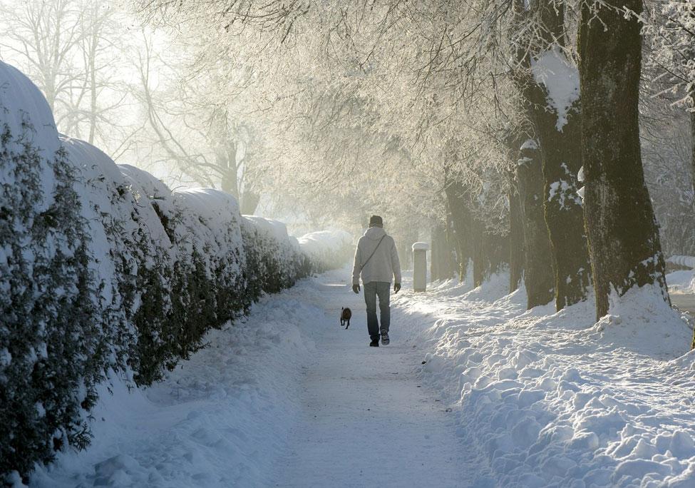 man walking in snow, winter depression